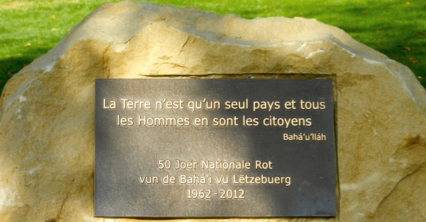 Luxembourg City's mayor Xavier Bettel unveiled a monument on 30 October 2012, marking the 50th anniversary of the first election of the National Spiritual Assembly of the Baha'is of Luxembourg.